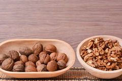 Walnuts on wooden bowls Royalty Free Stock Photography