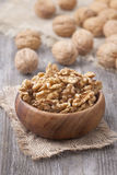 Walnuts in wooden bowls Stock Images