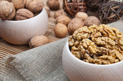 Walnuts in wooden bowls Stock Photo