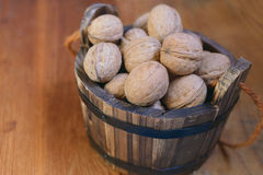 Walnuts in a wooden bucket Stock Photos