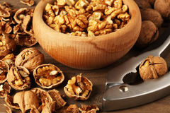 Walnuts on wooden cup Stock Photo