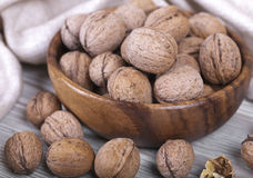 Walnuts in a wooden cup. Fresh walnuts, wooden cup with the nuts, healthy food Stock Images