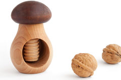 Walnuts and wooden nutcracker Stock Image