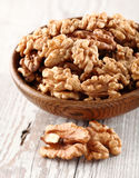 Walnuts in a wooden plate Stock Images