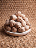 Walnuts on a wooden plate Stock Images