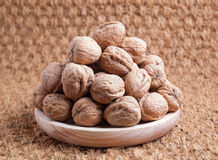 Walnuts on a wooden plate Royalty Free Stock Images