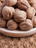 Walnuts on a wooden plate Stock Image