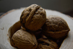 Walnuts in a wooden stand Royalty Free Stock Images