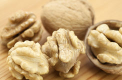 Walnuts on wooden surface Royalty Free Stock Photo