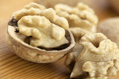 Walnuts on wooden surface Stock Photos