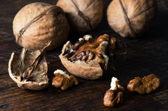 Walnuts on wooden table Royalty Free Stock Photo