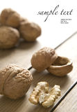 Walnuts on wooden table. Some walnuts on wooden table. Space for your text (easy to remove/change stock images