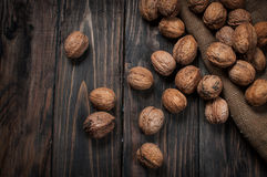 Walnuts on wooden table. assortment of nuts. Royalty Free Stock Photo