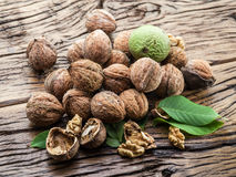 Walnuts on the wooden table. Royalty Free Stock Photos
