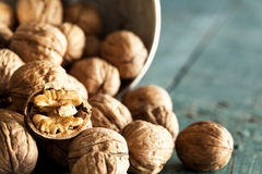 Walnuts on wooden table Royalty Free Stock Photography