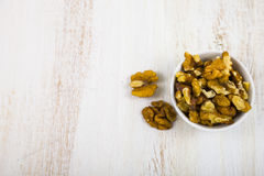 Walnuts on a  wooden table. Different kinds of tasty and healthy nuts. Top view Royalty Free Stock Photos