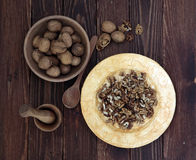 Walnuts on the wooden table flat lay top view Stock Photography