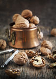 Walnuts on the wooden table Royalty Free Stock Image