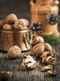 Walnuts on the wooden table Stock Image
