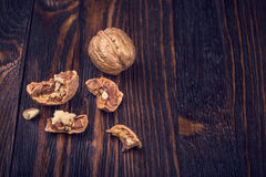 Walnuts on wooden table Royalty Free Stock Photos