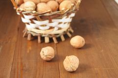 Walnuts on a wooden table Stock Images