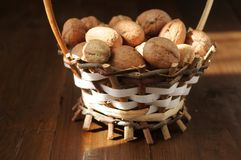 Walnuts on a wooden table Stock Photography