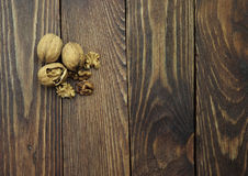 Walnuts on the wooden table Stock Photo