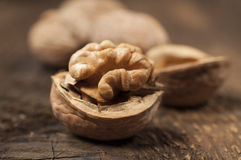 Walnuts on a wooden texture Royalty Free Stock Photography
