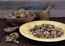 Walnuts in a wooden utensils on the table Stock Image