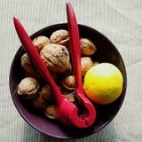 Walnuts. Yellow orange, walnuts and red nutcracker Stock Photography