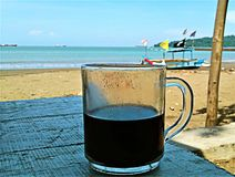 Walpaper relaxed, drink coffee in beach royalty free stock photo
