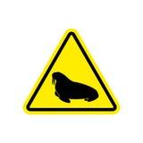 Walrus Warning sign yellow. Seal Hazard attention symbol. Danger Stock Images