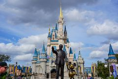 Walt Disney And Mickey Mouse Partners Statue In Front Of Cinderellas Castle Royalty Free Stock Photos
