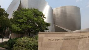 Walt Disney Concert Hall. Los Angeles, California, United States - August 9, 2018: futuristic structure of Walt Disney Concert Hall designed by Frank Gehry stock video footage