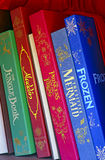 Walt disney fairy tale books. Collection of famous walt disney fairy tale books on shelf Royalty Free Stock Photos