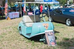 Walt Disney Marketeer Golf Cart på skärm Fotografering för Bildbyråer