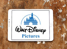 Walt disney pictures logo. Logo of the american walt disney pictures on samsung tablet on wooden background stock images