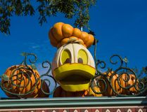 Donald Duck Pumpkin at Disneyland Halloween. Walt Disney`s amusement park decorations for Halloween include Disney characters carved into pumpkins Royalty Free Stock Photos