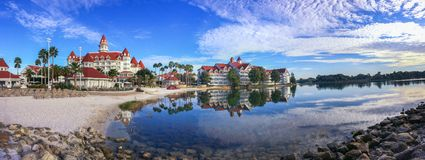 Walt Disney& x27;s Grand Floridian Resort & Spa. Walt Disney World's Grand Floridian Resort and Space during the early morning. Panoramic view of the beach royalty free stock photography