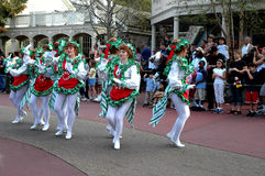 Walt Disney World Christmas Parade. Members of the Walt Disney World cast perform for visitors at the Disney Holiday Parade, on December 25th, in Orlando Royalty Free Stock Photo