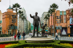 Walt and Mickey statue. Statue of legendary creator Walt Disney and his notorious character Mickey Mouse, holding hands displayed at the entrance of Disney Stock Photo
