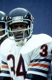 Walter Payton of the Chicago Bears. Walter Payton running back sitting in the rain on the bench Stock Images