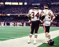 Walter Payton, Jim McMahon Superbowl XX. Former Chicago Bears superstars Walter Payton and QB Jim McMahon, watching from the sideline in Super Bowl XX. (Image stock photos