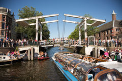 Walter Süskindbridge. Tour boats entering the Nieuwe Herengracht at the Walter Süskindbridge in the center of Amsterdam stock photography