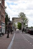 Walter Süskindbrug on Amsel in Amsterdam with view on the Magere Brug, visiting the city of Amsterdam, Holland, Netherland royalty free stock photo