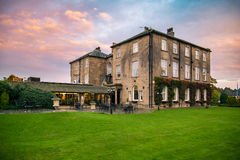 Walton Hall in a scenic setting of rolling parkland. Royalty Free Stock Images