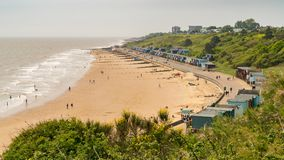 Walton-on-the-Naze, Essex, England, UK. May 29, 2017: Beach Huts at the Southcliff Promenade with people on the beach Stock Images