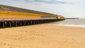 Walton-on-the-Naze, Essex, England, UK. May 29, 2017: The Walton Pier, seen from the beach Royalty Free Stock Photos