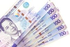 Waluta banknoty rozprzestrzeniają przez ramowego Philippines peso w różnorodnym wyznaniu zdjęcia stock