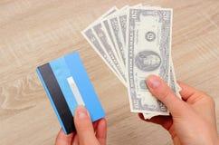 Waluta dolar i kredytowa karta w ręce, finansowy pojęcie Obrazy Stock